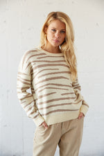 White and taupe zebra print sweater.