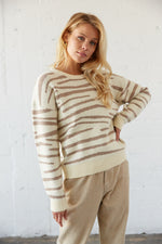 Striped zebra print sweater in mocha and cream.