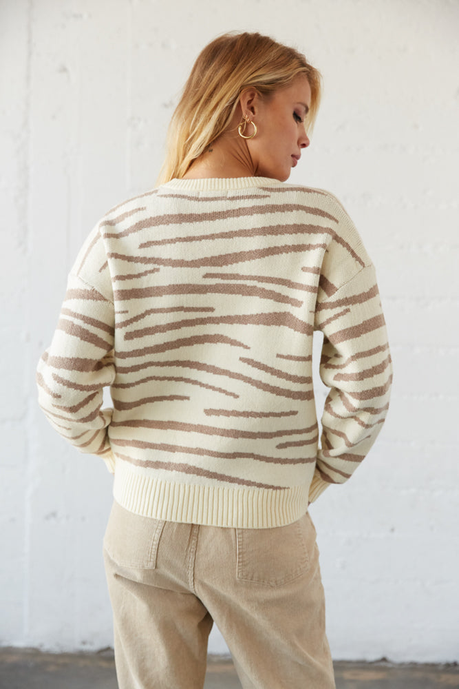 The back of this sweater is relaxed with a soft knit design.