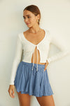 Blue flowy shorts with elastic waistband.
