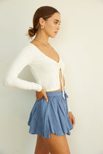 The side of these shorts are flowy and ruffled.