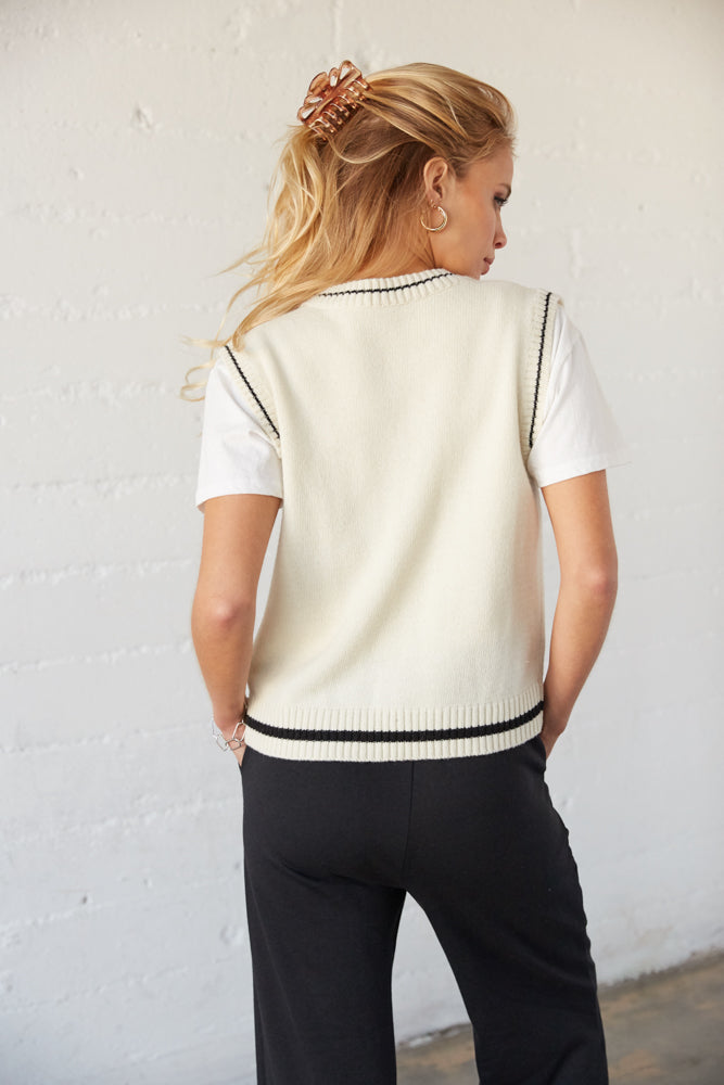 The back of this sweater vest is relaxed with a ribbed hemline.