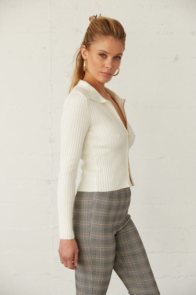 The side of this long sleeve top has a ribbed knit design.