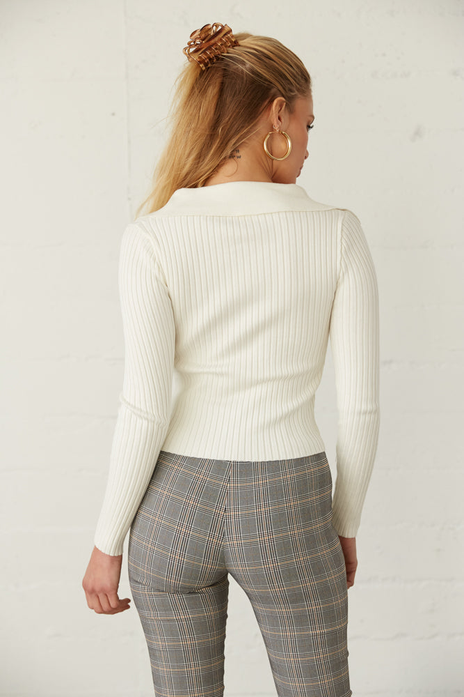 The back of this sweater top is ribbed with a fitted silhouette.