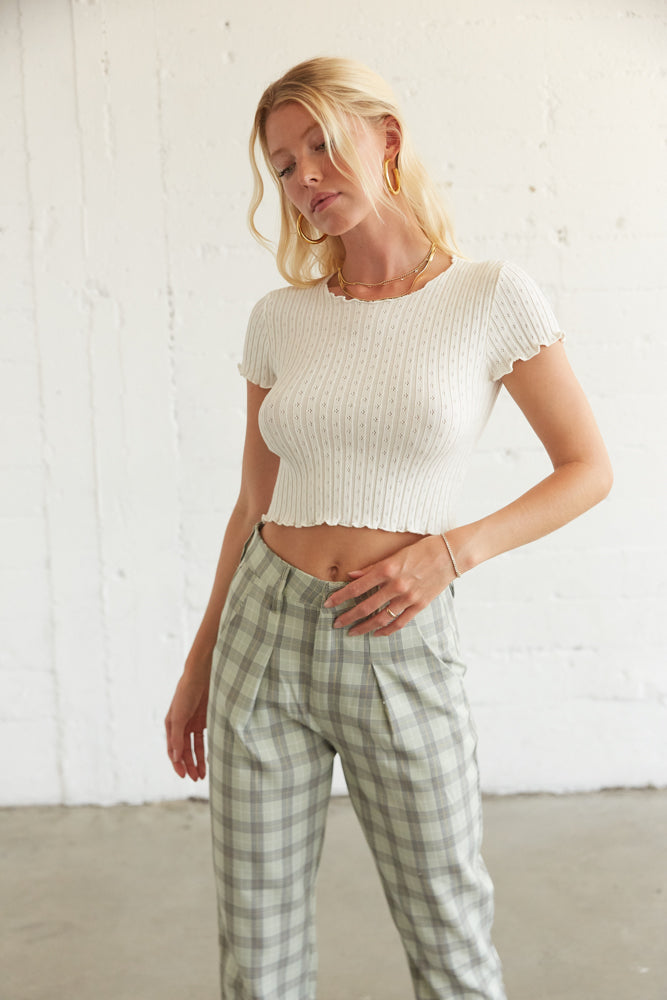 White ribbed knit top.