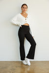 Black ribbed flare pants.