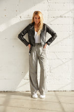 Grey plaid trousers with crop jacket.