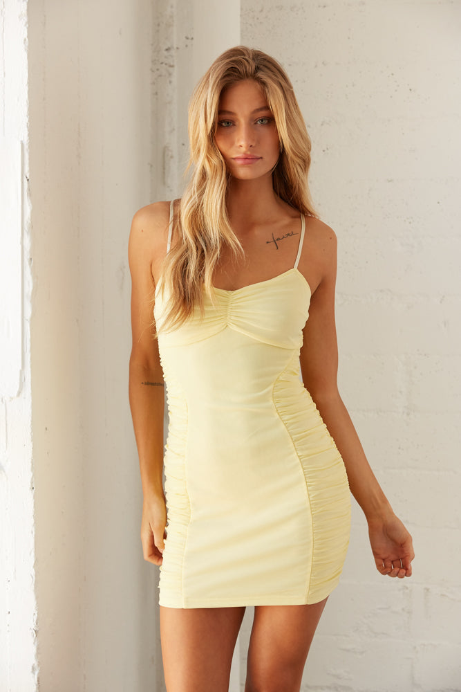 Front view of yellow mini dress.