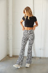 High rise flare leggings in zebra print.
