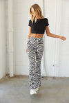 Black and white zebra flare leggings.