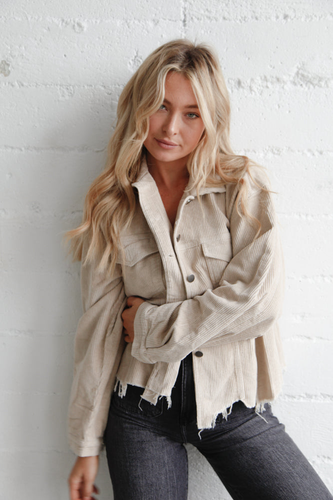 This jacket is complete with a distressed hem.