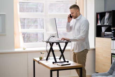 Man working from home at a standing desk