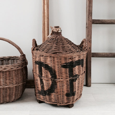Old French Carboy Glass Wine Bottle in Wicker Basket