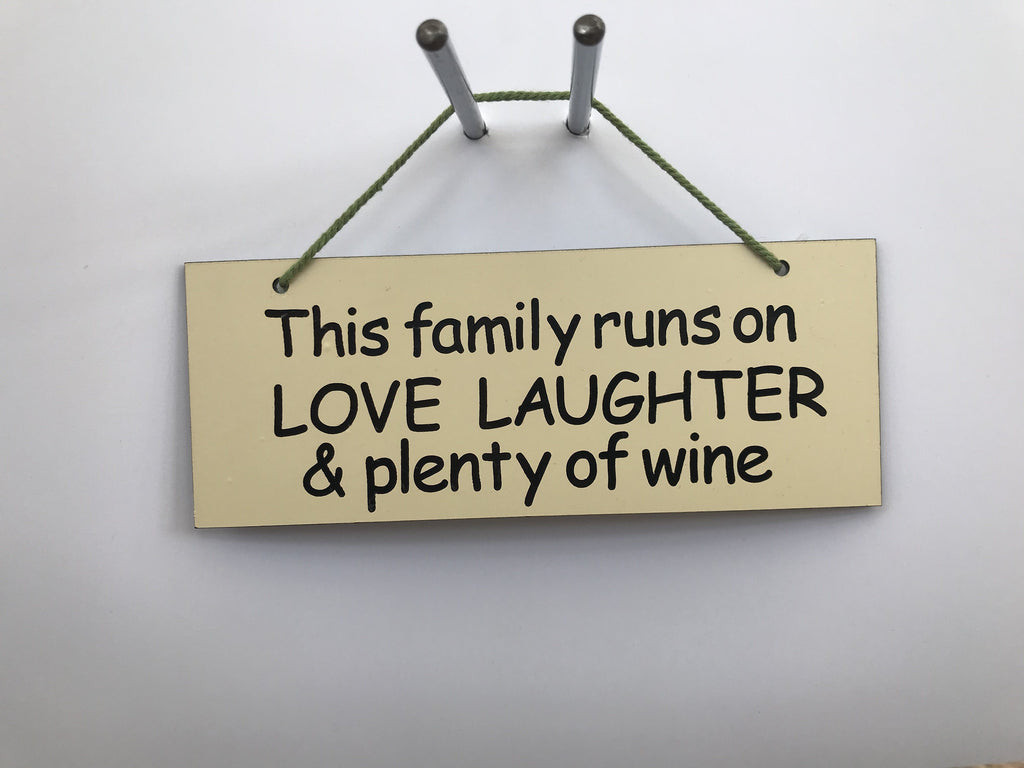 This family runs on LOVE LAUGHTER & plenty of wine Gifts www.HouseSign.co.uk