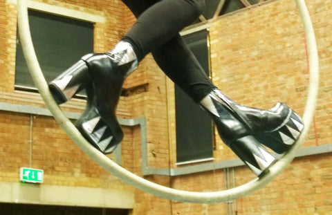 Model Wearing Black and Silver Leather Platform Boots in a Circus Hoop