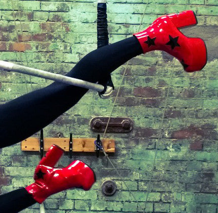 Red Patent Leather Platform Circus 70's Boots with Black Stars Modelled Performing at The Circus