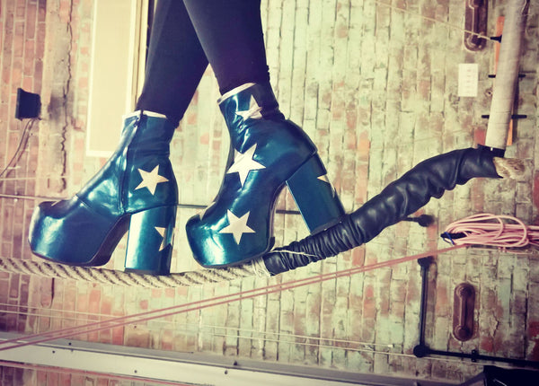 Walking on a Rope Wearing Vegan Stardust Metallic Teal Platform Ankle Boots with Silver Stars
