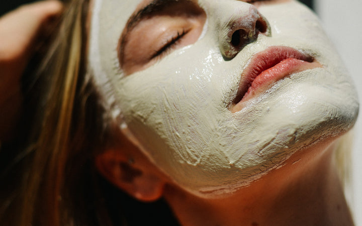 Woman with facial cream mask