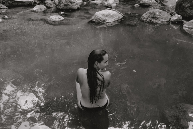 Woman sitting in a river