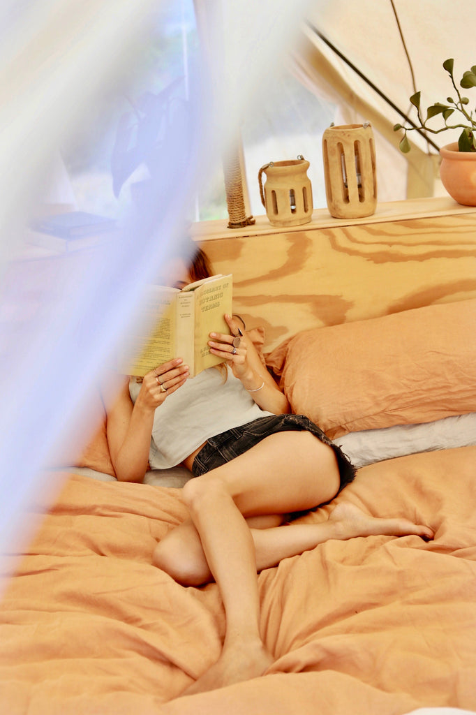 Woman reading on a bed