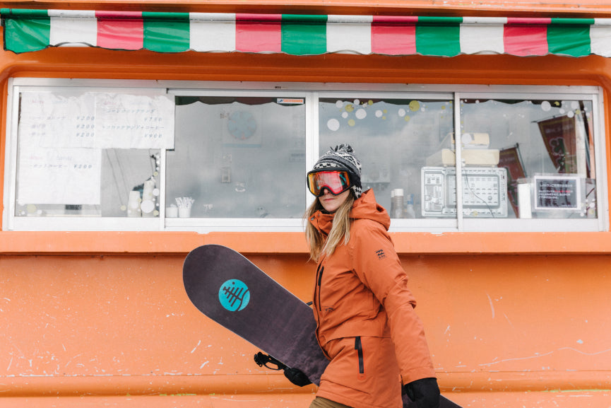 Snowboarder infront of a Crepe truck in Japan