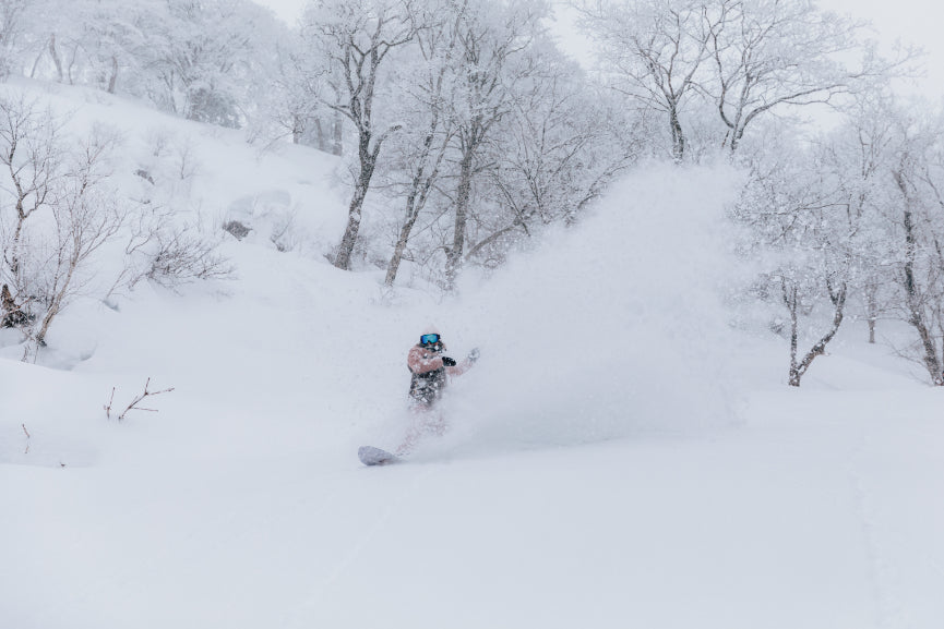 Snowboarder riding in Japan