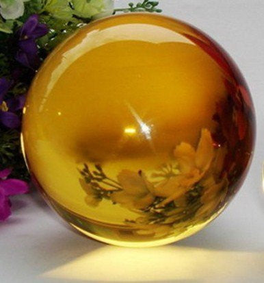 50mm Yellow Crystal Ball This crystal ball has been a timeless icon of divination and fortune telling for years upon years. Includes Stand and velvet pouch by The Spell Works.