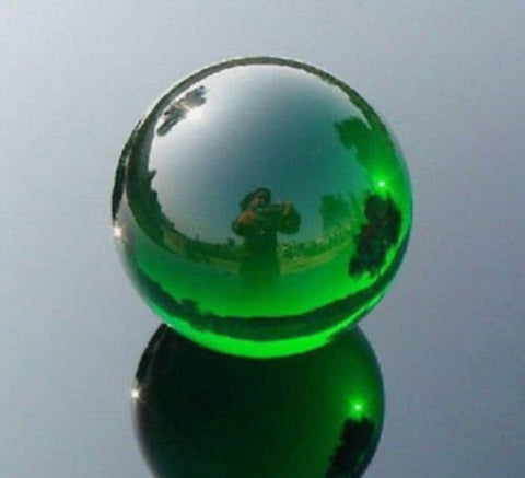 40mm Green Crystal Ball This crystal ball has been a timeless icon of divination and fortune telling for years upon years. Includes Stand and velvet pouch by The Spell Works.