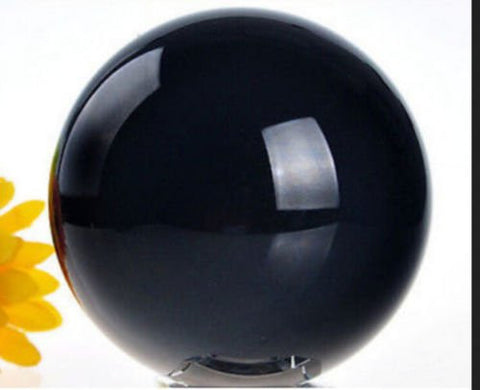 40mm Black Obsidian polished Crystal Ball This crystal ball has been a timeless icon of divination and fortune telling for years upon years. Includes Stand and velvet pouch by The Spell Works.