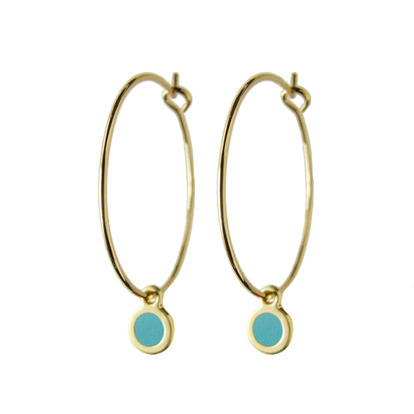 Delicate gold hoop dot earrings in pacific