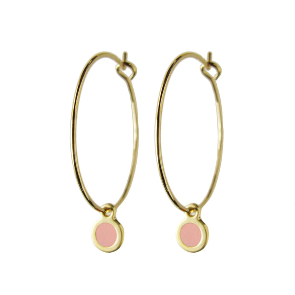 Delicate gold hoop dot earrings in blush