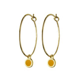 Delicate gold hoop dot earrings in emerald