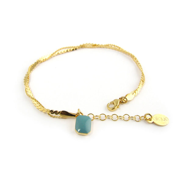 Double chain gold bracelet with enamel charm