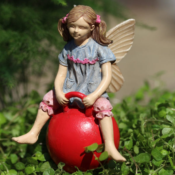 Jordan Mini Fairy Sitting on Hop Ball: Backyard Miniature - Baby Feathers Gift Shop