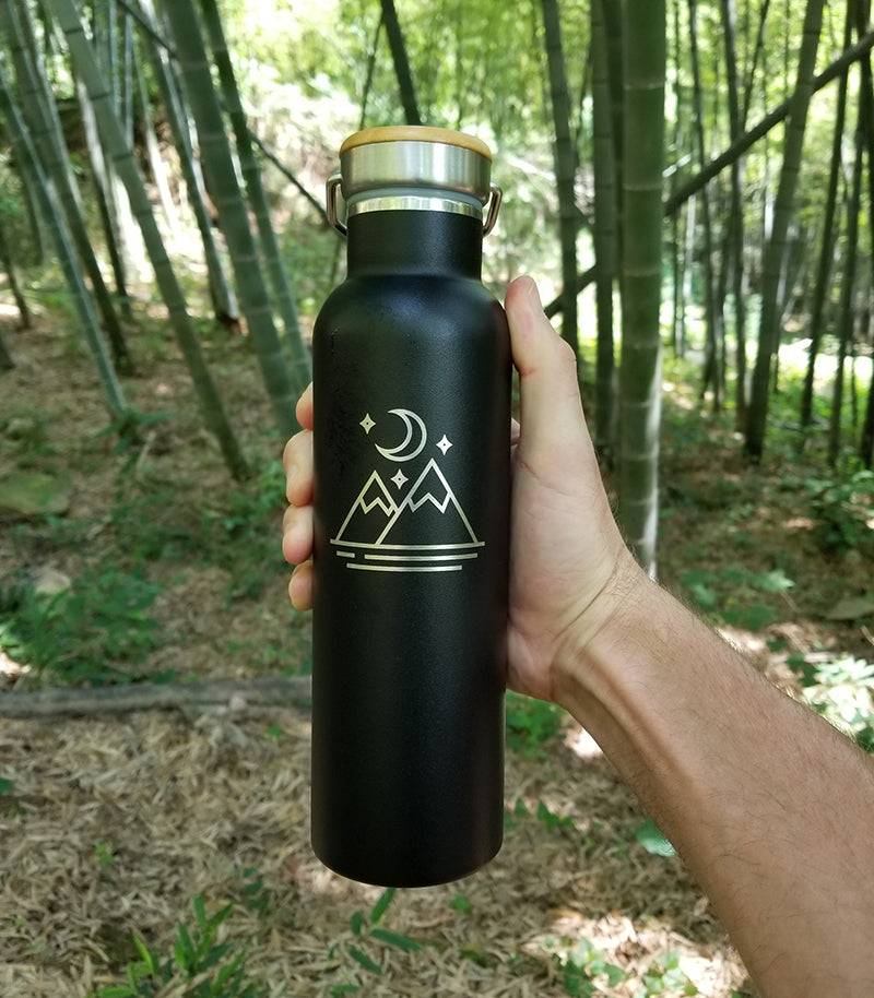 tree tribe water bottle in the forest