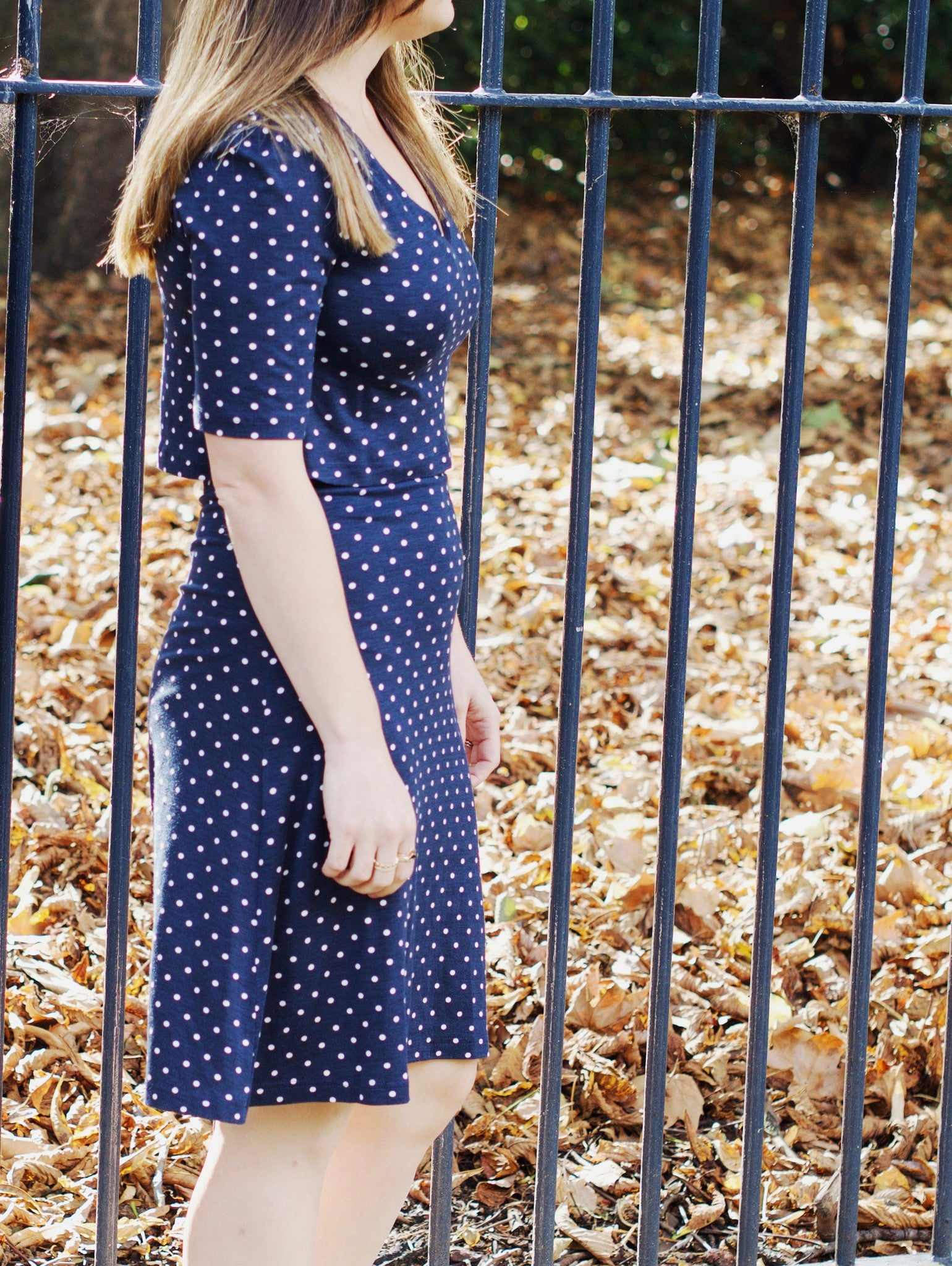 navy polka dot t dress walking image