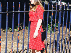 red polka dot t dress walking image