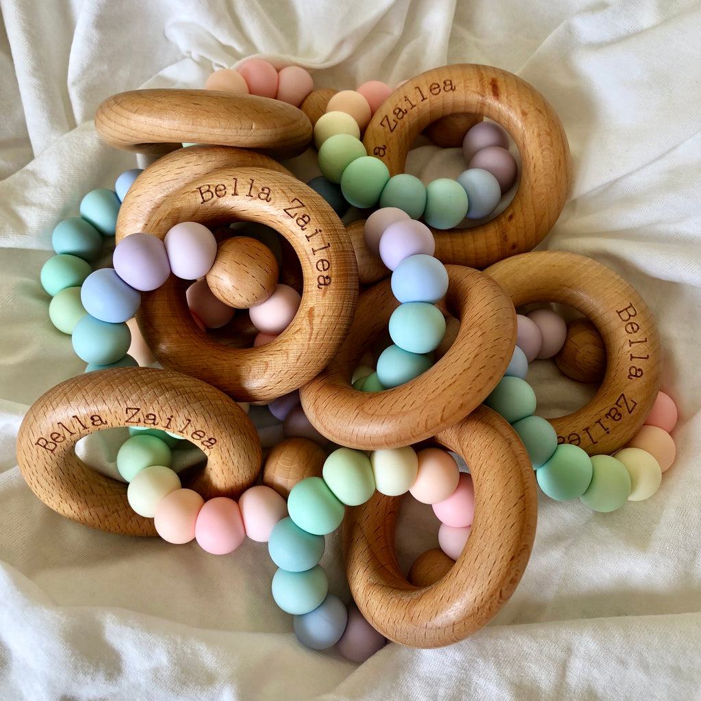 pastel rainbow beech wood wooden ring and silicone bead teething toy