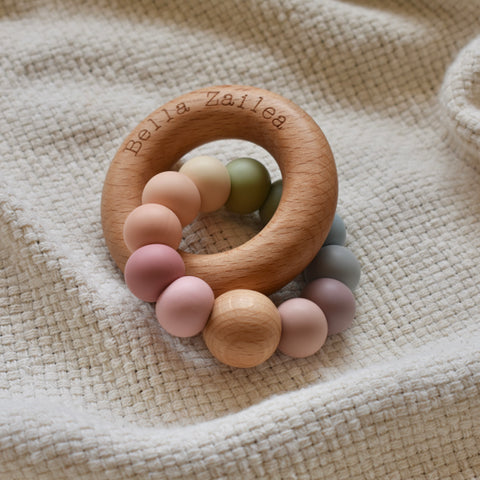 Muted Rainbow Nova silicone & beech wood teething toy