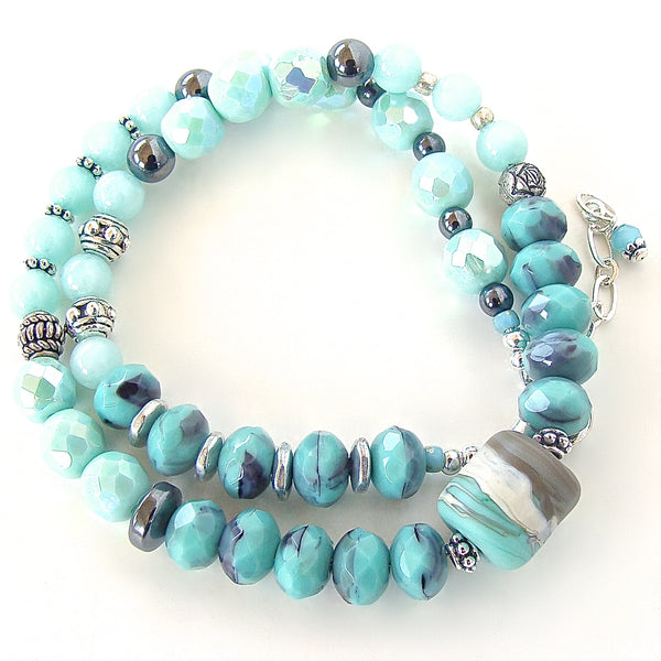 Beaded wrap bracelet in aqua and purple