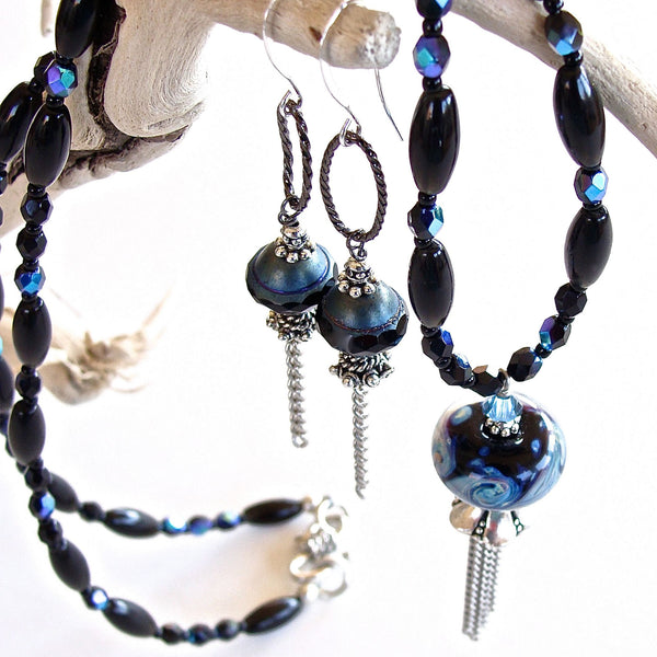 Black and blue jewelry set with silver tassel