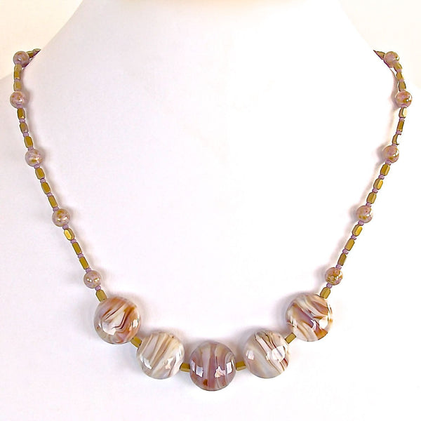 Handmade delicate beaded necklace in warm neutrals