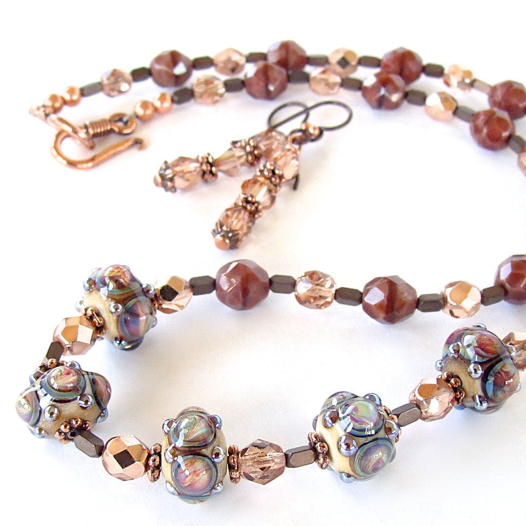 Handmade glass jewelry in rose tones