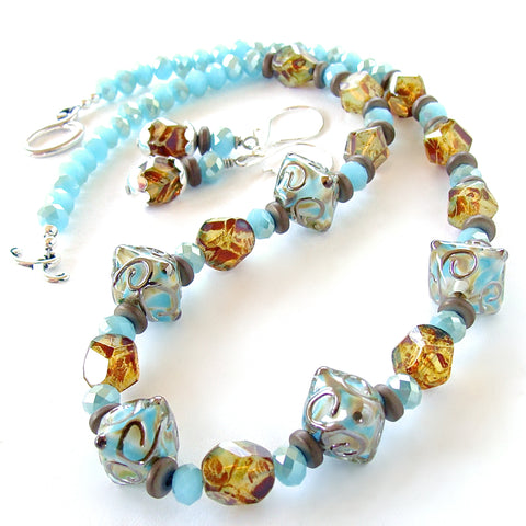 Light blue crystal necklace with art glass