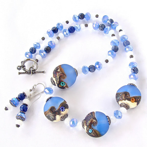 art glass necklace in blue and white