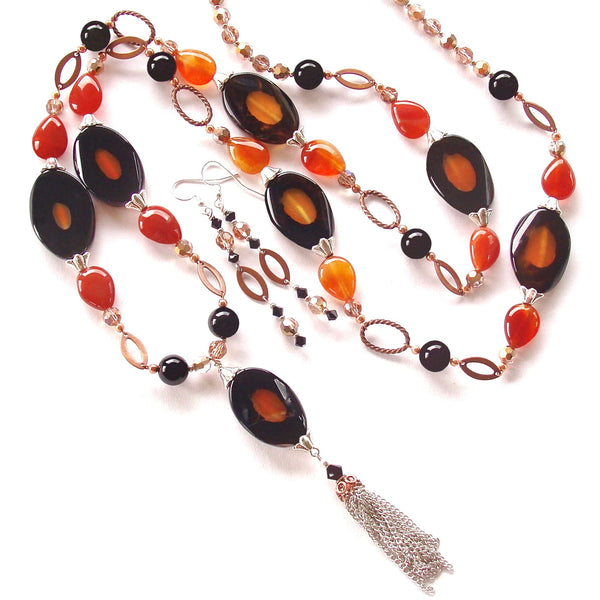 long pendant necklace in orange and black