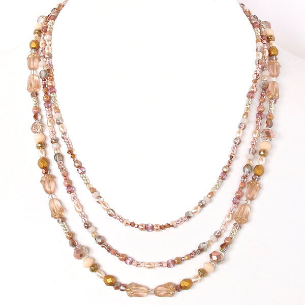 mixed metal necklace with rose gold accents