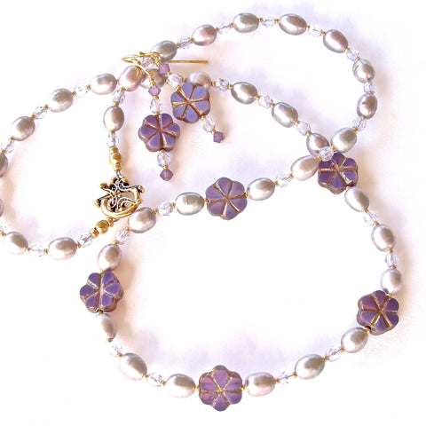 petite pearl necklace with purple flowers