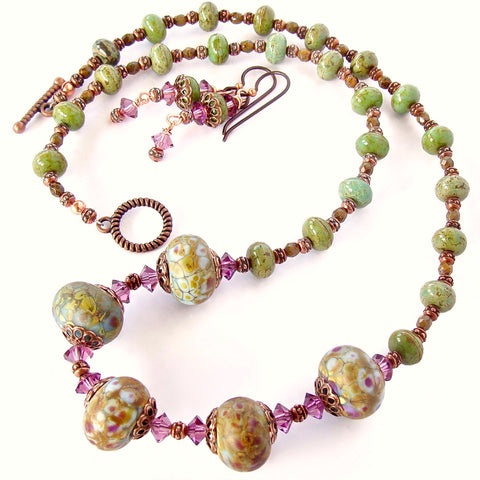 purple and green necklace with art glass