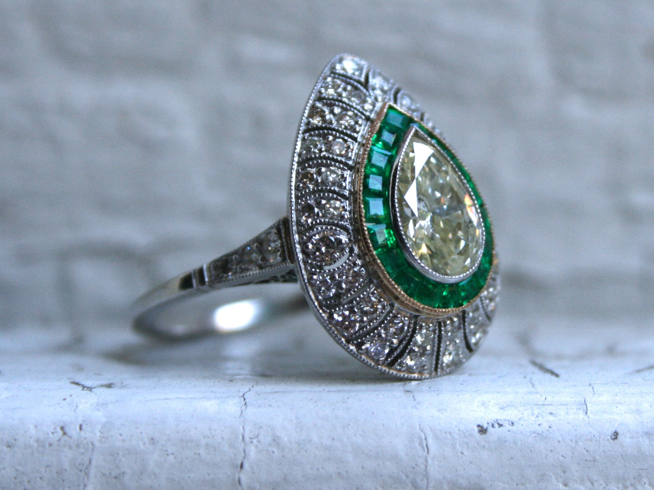 Stunning Pear Cut Diamond and Emerald Halo Ring Engagement Ring in Platinum - 2.45ct.